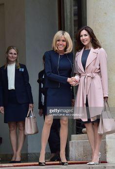 News Photo : French president's wife Brigitte Macron shakes...