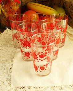 Perfect gift for a glass collector. Swanky Swigs very popular in the 1950's featuring vivid decals such as these red daisy glasses. ~ Clear glass, red daisies, various sizes. ~ Collectible glassware from the mid-century.