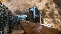 There's seating for 32 at this table. The extraordinary 100m long cave deep inside cliffs above Tasmania's Derwent River is Australia's largest private cellar  Read more: http://www.news.com.au/realestate/man-cave-in-tasmania-yours-for-3-million/story-fncq3era-1226692690525#ixzz2bonimfcS