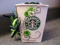 Starbucks Mini-Album by Ms.Jackie on Scrapbook.com. Made using a venti Starbucks paper cup and a Bind-It-All album binding tool.