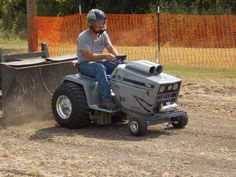 Patrick Bramlett pilots his 'Warthog' tractor, during LSGTPA competition Garden Tractor Pulling, Engine Repair, Small Engine, Pilots, Tractors, Lawn, Competition, Monster Trucks, Mini