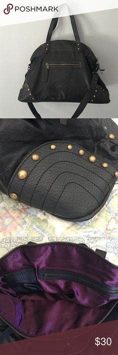 """Studded Leather/Canvas Overnight Bag Gorgeous overnight bag. Shell is cotton canvas with leather trim and interior is silk lined. No damage or signs of wear besides light scratch on the bottom (pictured). Base of bag is 9"""" x 21"""" height is 14"""". Removable shoulder strap. Very stylish. Bags Travel Bags"""