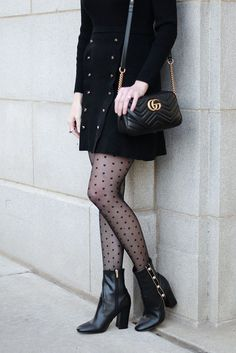 black and gold holiday party outfit idea, black sweater dress, black boots with gold buttons, polka dot tights, black gucci marmont bag #holiday #holidayparty #holidaypartyoutfit #gucci #tights #boots #ankleboots