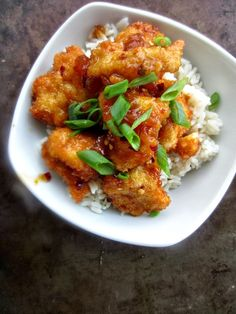 Sweet & Spicy Orange Chicken | Crispy chicken tossed in a tangy orange sauce--perfect for those nights when you are craving take out at home. #chicken