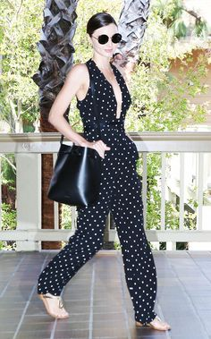 Miranda Kerr in a polka dot jumpsuit, sandals, and round sunglasses. Celebrities are all about the jumpsuits! How do you feel about this trend?
