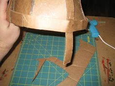 Happily Ever Crafter: DIY: Building a Medieval Helmet Out of Cardboard Hiccup Costume, Shrek Costume, Celtic Costume, Medieval Banner, Knight Shield, Medieval Helmets, Knights Helmet, Deco, Boy Room