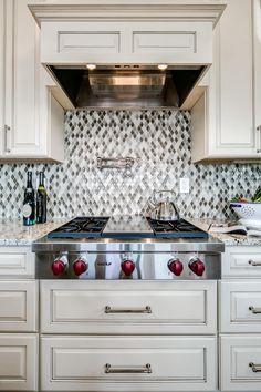 Kitchen Features Eye-Catching Mosaic Tile Backsplash