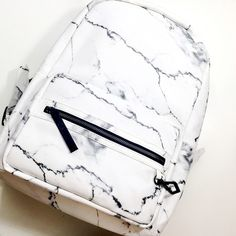Brand new marble print faux leather backpack from the Eddie Borgo x Target collab. This is a full size backpack, not a mini and was an online exclusive item. Never used, still has the paper stuffing inside. Did not come with tags attached. Price is firm unless bundled.