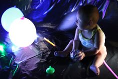 Play At Home Mom LLC: Adventures in the Dark  This website is SO FUN!! SOO many ideas to do  of things to do with the kids that help them learn! This one is a big bubble made out of a tarp so they could play glow in the dark toys all day :)