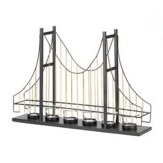 Found it at Wayfair - Zingz & Thingz Suspension Bridge Candelabrahttp://www.wayfair.com/Zingz-and-Thingz-Suspension-Bridge-Candelabra-10015495-ZNGZ2518.html?refid=SBP