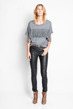 Zadig & Voltaire round neck T-shirt with short sleeves and fringing on the chest. 65% viscose, 20% wool, 15% angora. The jersey is worked for a long period to obtain unique, creative results. Each piece demonstrates skill and attention to detail.