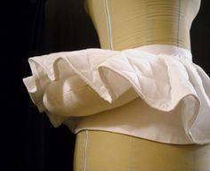 A French farthingale/bum roll held the round shape of the dress at the waist and let it fall nicely to the floor
