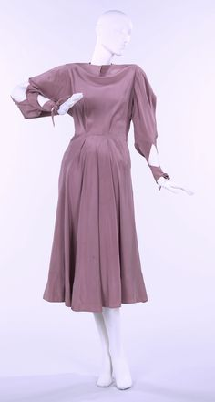 """Dress, Charles James (American, born Great Britain, 1906–1978): 1946, American, silk. """"This dress was designed specifically for Mrs. Rogers from a remnant. The sleeve treatment is of most interest. The lace-up ties over the arms are of particular note in relation to the sense of bondage and the seductive exposure of the arms through the outer slits."""""""