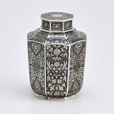 "Silver and Niello tea caddy with tapered octagonal vessel with double-lobed shoulders and octagonal cap, intricate decorations of foliage and interlaced arabesques in the Persian manner. Made for Tiffany & Co., Moscow, 1892. Latin monogram ""S"" on lid. Marks for Antip Kuzmichev, 88 standard, Aleksandr Smirnov assayer. 4 1/2"". 8.8 OT - SOLD for 6.000 $"