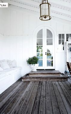 Nice white. Love the box seat and bleach raw wood floor. The door with arch is simply sweet and interesting!