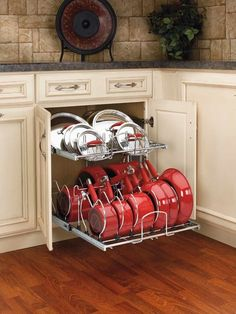 This is how pots and pans should be stored. Lowes and Home Depot sell these. SO smart!