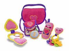 Melissa & Doug Pretty Purse Fill and Spill Toddler Toy Everything necessary for the little girl on the go fits into this pretty purse! This soft play set includes a cell phone that chimes, a key ring with keys, a change purse with coins and a compact with a child-safe mirror. Everything is easily removed and replaced into a charming pink purse with a purple handle. Constructed of high-quality fabrics and plastic, this durable set will provide hours of pretend fun! #giftforgirl #prettypurse