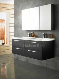 The Hudson Reed Quartet Furniture Pack will completely transform the look of modern bathrooms. Supplied in a sleek Black Wood finish. In stock now. Bathroom Storage Solutions, Bathroom Furniture, Vanity Units, Bathroom Furniture Sets, Vanity, Toilet Vanity Unit, Mirror Cabinets, Double Vanity Unit, Wall Mounted Vanity