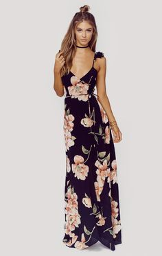 """Roe + May brings the most romantic maxi dress to the market with the Savona Maxi. Featuring their gorgeous wildflower print with ruffle straps and wrap skirt, this is our new favorite for fall.ImportedDry Clean Only100% Rayon CrepeFit Guide:Model is 5ft 7 inches; Bust: 32"""", Waist: 24"""", Hips: 34""""Model is wearing a size XSBody Con FitShoes Featured Not Available For Purchase"""