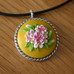 Yellow pendant with pink white flowers by jainnie.jenkins, via Flickr http://www.jainniejenkins.com