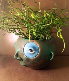 This one of a kind sculpture designed to be a stand out in your garden or in your home.  She is made of high fire clay and fired to 2200 degrees.  There is a hole in the top and  you can plant anything you like in her.  I think these pieces look great with succulents, cat grass or anything that gro