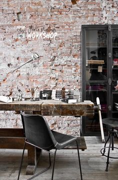 home office exposed brick walls
