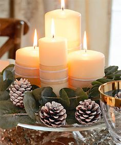 Candles, pine cones and greenery Christmas Flowers, Christmas Candles, Christmas Centerpieces, Xmas Decorations, Magical Christmas, Rustic Christmas, White Christmas, Christmas Time, Candle Arrangements