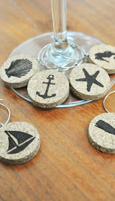 Sick of those metal wine charms that bang on your delicate wine and drinking glasses when you take a sip? Worry no more with these nautical cork wine glass charms!