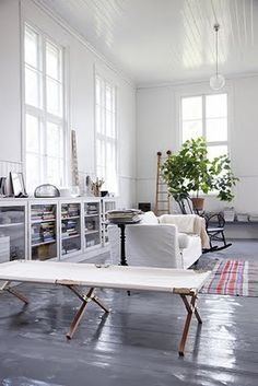 tall windows, grey wood floors
