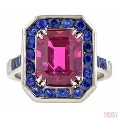 Vintage emerald cut rubellite and sapphire ring in platinum. From Doyle & Doyle.
