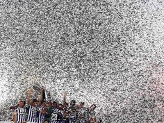 Juventus players celebrate with the trophy after winning their Italian Super Cup match against Lazio at the Olympic Stadium in Rome - via http://theguardian.co.uk/football