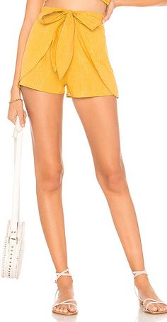 Cleobella X REVOLVE Indio Short in Yellow. - size L (also in M,S,XS) Cleobella X REVOLVE Indio Short in Yellow. - size L (also in M,S,XS) 98% cotton 2% lurex. Hand wash cold. Hidden front zipper closure. Draped front with tie detail. Metallic thread accents. Shorts measure approx 12 in length. CLEO-WF13. CRCS1825. Cleobella's products are hand made in Bali and emphasize the artistic skills and beauty of traditional craftsman techniques.