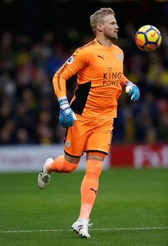 Kasper Schmeichel of Leicester City controls the ball during the Premier League match between Watford and Leicester City at Vicarage Road on December 26, 2017 in Watford, England.