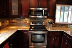 """Golden Carmel granite with multi-colored natural slate tile backsplash design. This beautiful tile backsplash was cut from 12"""" tiles, into 1"""", 2"""" and 3"""" x 12"""" pieces."""