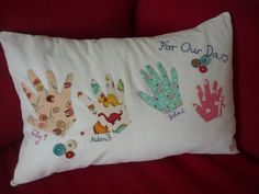 A handprint cushion I made for my dad, featuring the handprints of his grandkids!