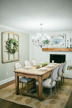 Fixer Upper... Gorgeous neutral dining room with brick fireplace