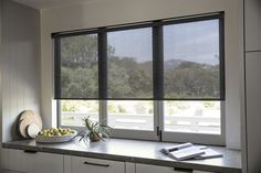 Spend your time indoors comfortably with our fade-free Solar Shades. This tastefully minimalistic design reduces glare and heat by diffusing bright sunlight in your home's most sun-drenched spaces. Kitchen Window Blinds, Window Blinds & Shades, House Blinds, Blinds For Windows, Shades For Windows, Modern Window Shades, Modern Blinds, Window Shutters, Window Curtains