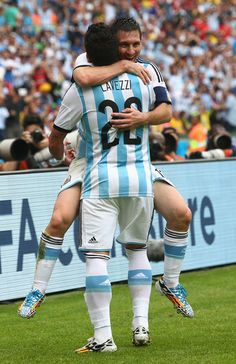 Lionel Messi of Argentina celebrates scoring his team's second goal and his second of the game with Ezequiel Lavezzi during the 2014 FIFA Wo...