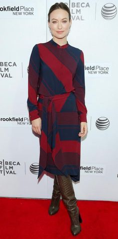 Olivia Wilde went for a coordinated look for the world premiere of Body Team 12 at the 2015 Tribeca Film Festival in a striped tie-neck top and matching bias-cut skirt, both by Tory Burch, with tall brown boots.
