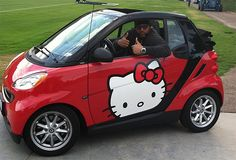 Only real men drive Hello Kitty smart cars...