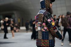 Highsnobiety's globe-trotting street style circus hits up Korea, with a second batch of wacky street style from Seoul Fashion Week SS17.