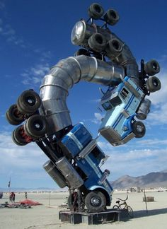 Whoa- semi truck yoga anyone? This sculpture was made for the festival Burning Man in 2007.