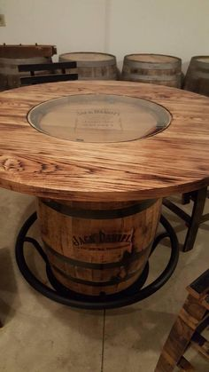 Jack Daniels Whiskey Barrel Table, with 4 Stave Chairs and Metal Footrest - (ask for freight quote) - Garden Chair Jack Daniels Whiskey Barrel, Whiskey Barrel Table, Wine Barrel Bar, Wine Barrel Chairs, Whiskey Barrels, Metal Barrel, Wooden Spool Tables, Wooden Spools, Wood Table