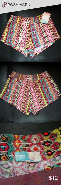 Cute colorful patterned shorts size Large Cute colorful patterned shorts! These cute shorts will go with a variety of colors, blue pink or white or black tank top. Size large in new condition! Cali 1850 Shorts