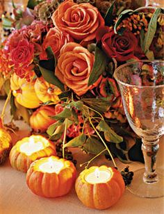 Style Ideas for a Rustic Fall Reception: accent centerpieces that include autumnal-hued roses, hydrangeas, and scabiosa pods, with some miniature pumpkin, pear, and apple votives.