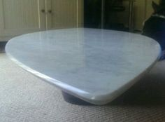 Carrara Marble Surf Board styled piece with a reverse bullnose edge detail, handcrafted and finished. Perfect as a coffee table or brilliant as an alternative Bar Surface for your home. www.stonesmart.co.uk/bespoke-items/ 01527 757007 info@stonesmart.co.uk