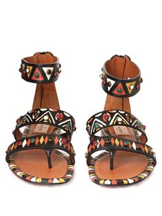 Valentino's SS16 collection has a distinctly nomadic feel. In a nod to the colours and patterns of Africa, these flat gladiator sandals are hand-painted with tribal-inspired motifs and studded across each strap.