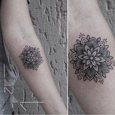 Mandala tattoo on the left inner forearm.