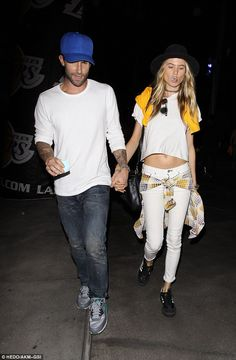 So in love: They tied the knot in July and Adam and wife Behati are clearly still very much in the newlywed phase