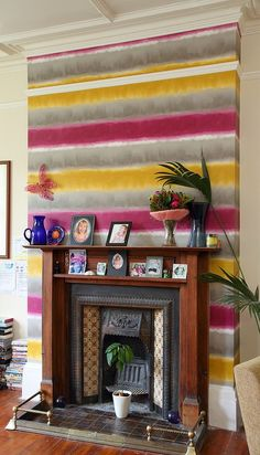 Striped Accent Walls: Create a bright and funky accent addition with colorful wallpaper